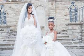bride and young daughter dress alike on her wedding day essence com