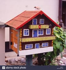 home mailbox in the form of a little traditional miniature swiss