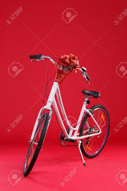 large gift bow white bicycle on a background with a large gift bow stock