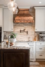 Unique Backsplash Ideas For Kitchen by Unique Kitchen Interior Design White Cabinets Copper Hood Stone