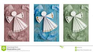 handmade christmas decorations paper angel on wooden background