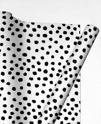 black and white wrapping paper dots black and white as gift wrap by winter juniqe