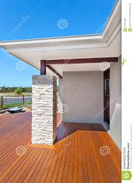 modern house entrance from the side with wooden floor and a ston