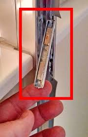 the shower door magnet which was mounted to the shower frame that