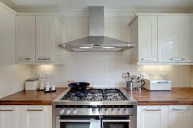 stainless steel hood fan a stainless steel kitchen hood stands over island fitted regarding
