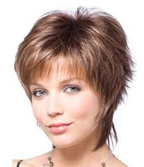 feathery haircuts for mature women short face flattering bob with feathered layers and wispy ends