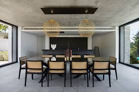 Modern House Dining Room - this concrete house was designed with amazing views overlooking