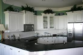 Black And White Kitchen Transitional Kitchen by White Transitional Kitchen Cabinets With Black Granite Countertops