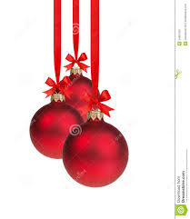 composition from three red christmas balls hanging on ribbon