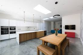 st mary s crescent isleworth grand design london white bespoke kitchen filled with light with a single kitchen island as the central focal