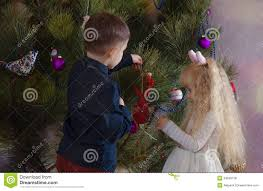 boy and busy decorating a christmas tree stock photo image