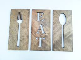 kitchen wall plaques kitchen fork spoon and eat wooden plaques by timberartsigns