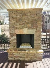 stacked stone fireplace with tv above home design ideas