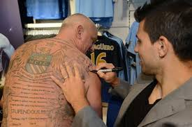 man city set to offer free laser tattoo removal to fans as and
