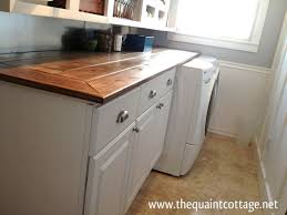 laundry room base cabinets this awesome laundry room countertop cost under 40 to make