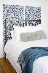 this diy statement headboard is the focal piece in this college