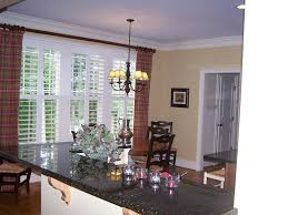 curtains on windows with plantation shutters fashion faux pas