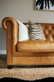 Decoro Leather Sofa by Camel Colored Leather Chesterfield Sofa Zebra Pillows Jute Rug