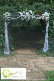 wedding arches decorated with tulle arbor decoration with blue and white flowers and tulle draping