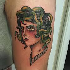 medusa tattoo on left bicep by fabio onorini