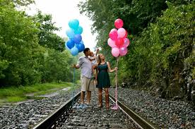 gender reveal balloons in a box balloon gender reveal photoshoot say what say what