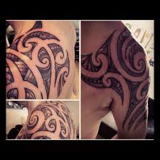 pacific islander chest back shoulder half sleeve tattoo