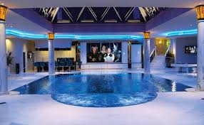 indoor infinity pool with movie theater and bar oh yeah and the