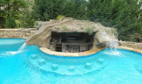 backyard grotto design with waterfall and bar would you want