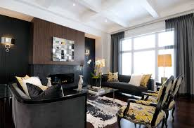 bedroom accent wall and black sofa with decorative pillows also