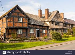A Framed Houses by Ancient Medieval Tudor Timber Framed Houses In Pembridge Stock