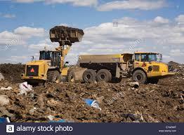 volvo loader on a hilltop at a waste management site quebec