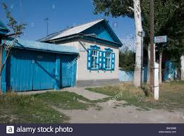 Traditional Style House by Traditional Style House In Karakol Kyrgyzstan Stock Photo