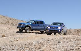 nissan frontier vs titan our cars 2012 nissan frontier when a raptor u0027s hero comes along