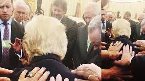trump redesign oval office evangelical pastors prays over laying hands on trump in the oval