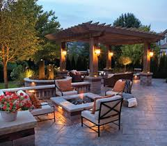 incredible unilock outdoor living space with fire pit and