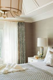 best 25 double curtains ideas on pinterest modern living room grasscloth wallpaper brass curtain rods statement chandelier soothing neutrals