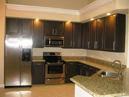 grey kitchen cabinets with granite countertops dark espresso kitchen cabinets with green granite countertop on