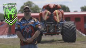 watch monster truck videos monster truck throwdown feature performer crushstation greg