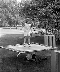 caroline kennedy jumps on a trampoline on the south lawn of the