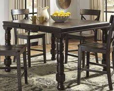 maysville counter height dining room table the maysville counter height dining table w 4 barstools from ashley