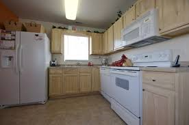white wood kitchen cabinets granite countertops white oak kitchen cabinets lighting flooring