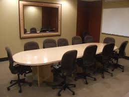 Office Furniture Meeting Table Black Swivel Chairs With Long Oval White Wooden Table Placed On