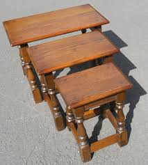 charm nest of three oak coffee tables