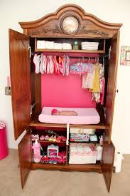tv armoire repurposed into a diaper changer diy diy projects