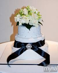 elegant white wedding cake with black ribbon myria