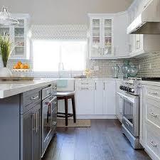 white kitchen cabinets with brown floors light gray brick kitchen backsplash tiles design ideas