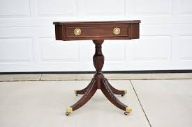 mahogany single drawer side table with brass toe caps by century
