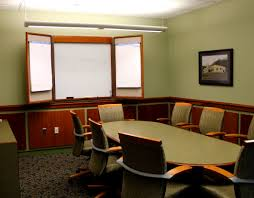 exclusive conference room design with dark brown modular table