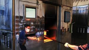 national cremation society reviews grave business undertakers vie for title of china s most skilled
