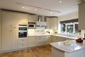 a luxury kitchen with lots of natural light an open plan design